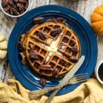 pumpkin spice waffles with butter and maple syrup