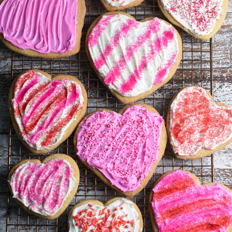 Heart shaped sugar cookies with pin frosting and sprinkles