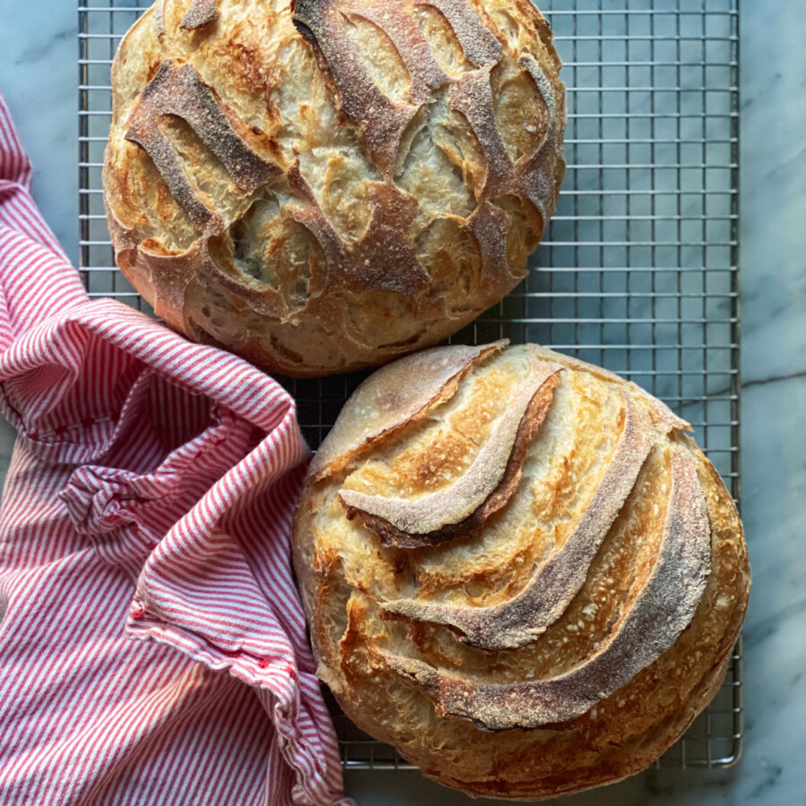 2 loaves of sourdough and a red and white napkin