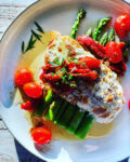 Mozzarella topped winner winner chicken dinner with tomatoes, mozzarella and asparagus
