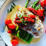 Mozzarella topped chicken with asparagus and tomatoes