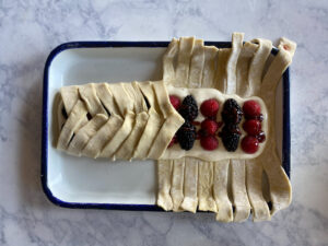 puff pastry being folded over berries