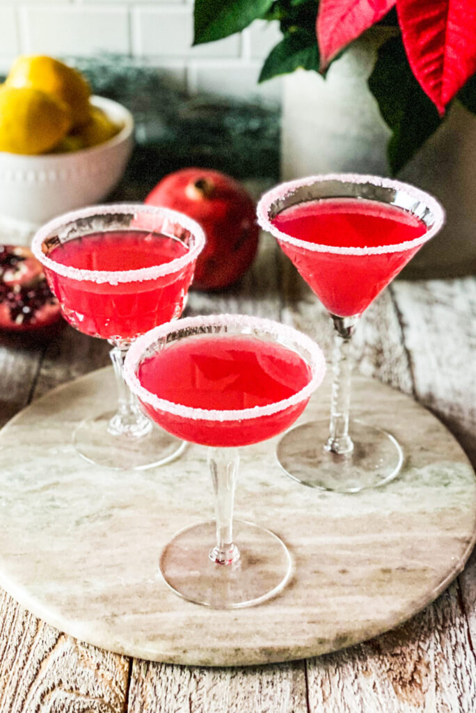 3 pomegranate lemon drop martinis with sugar dusted glasses