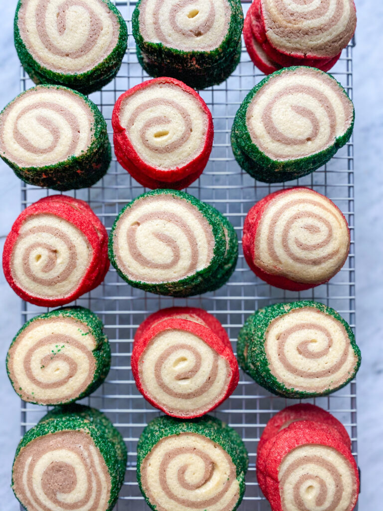 red and green pinwheel cookies and a cookie rack