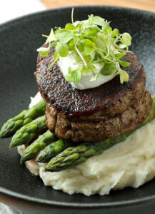 Mashed potatoes with asparagus and steak and herbs