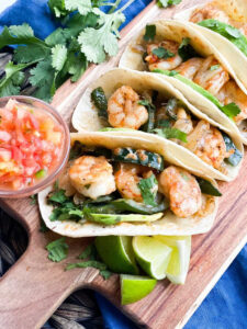 Valentines Day Dinner of shrimp tacos with poblanos, limes, salsa and cilantro