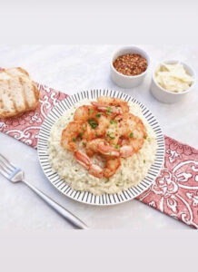 Valentine Dinner of 6 spiced shrimp over risotto with toasted bread, chili flakes and shaved parmesan