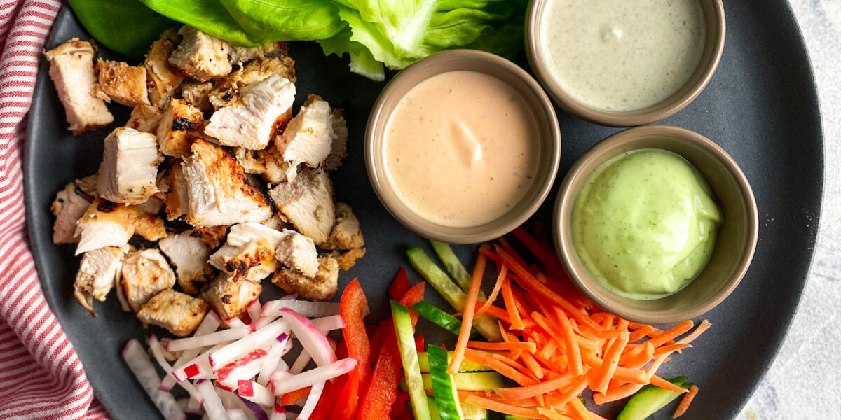 Grilled chicken, sliced cold veggies, 3 yogurt sauces and lettuce.
