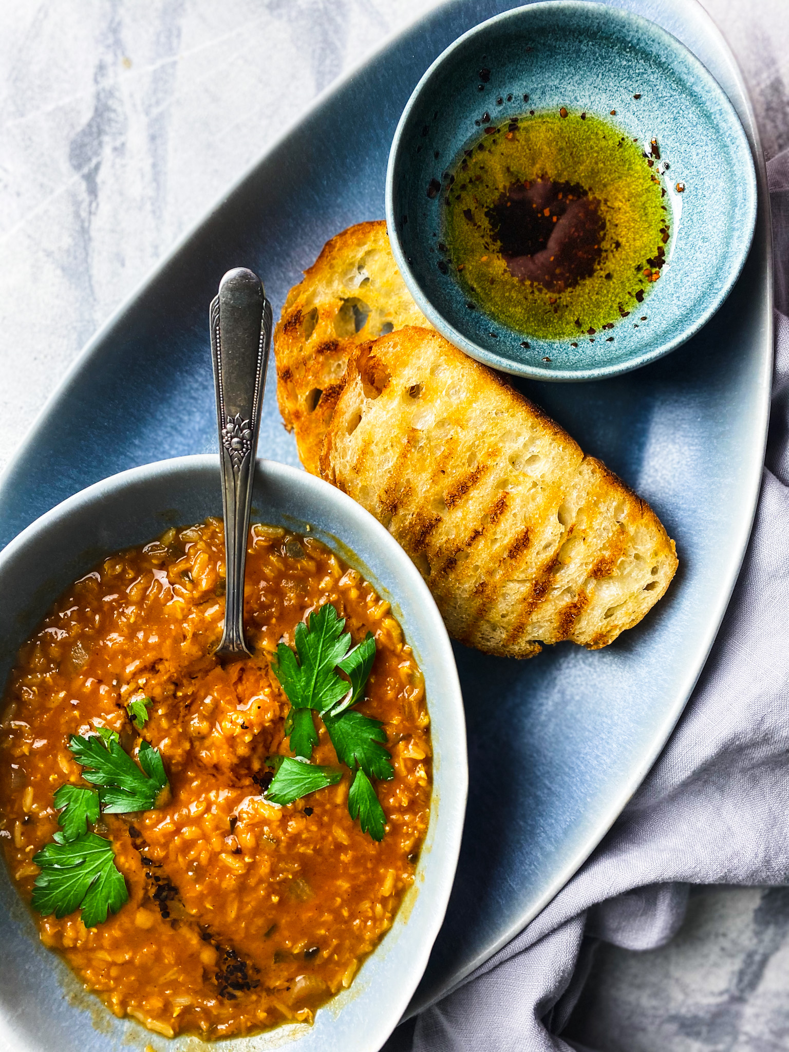 Redi lentil soup with grilled bread and toasted Aleppo pepper olive oil