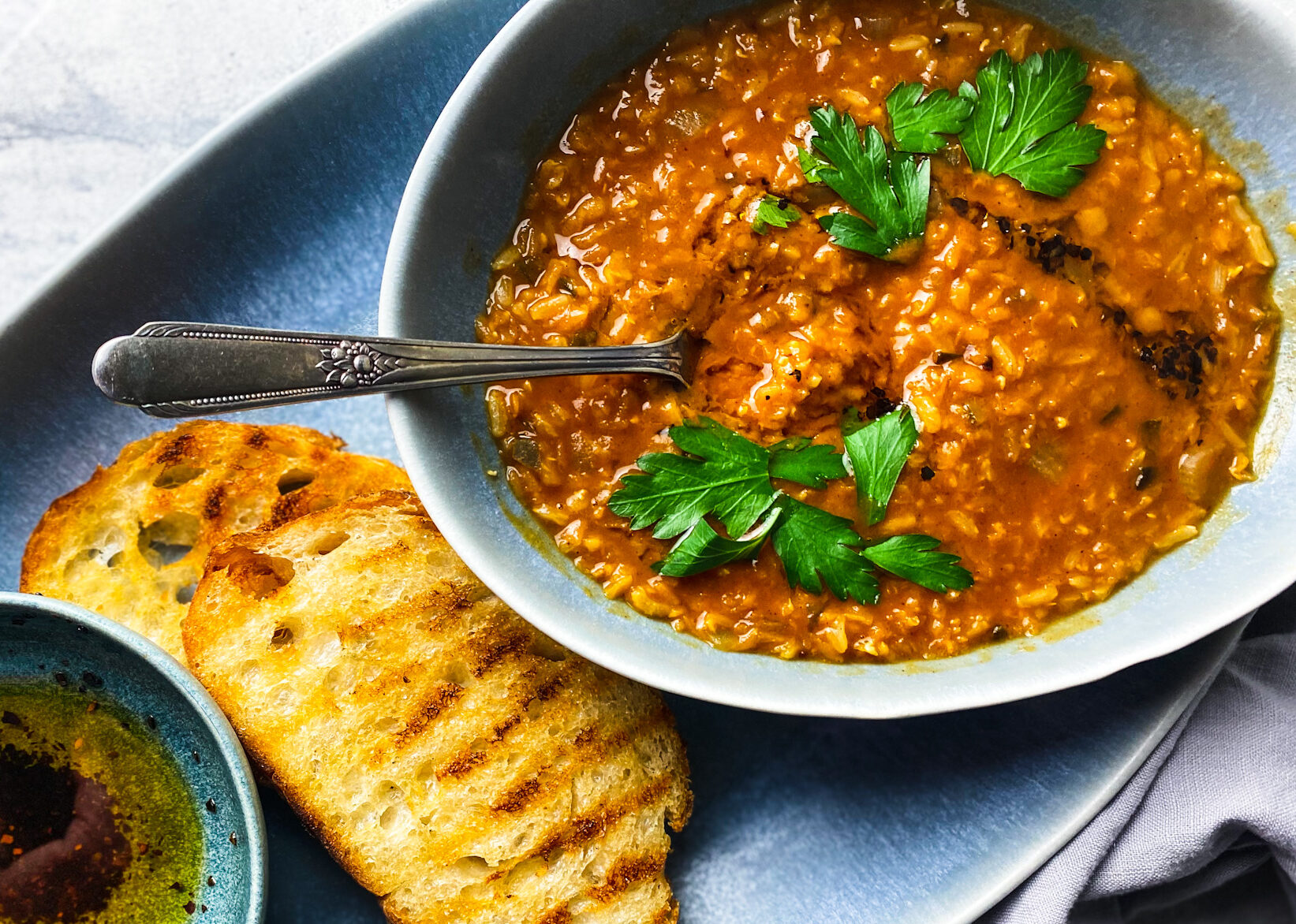 red lentil soup with parsley, grilled sourdough and toasted Aleppo pepper olive oil.