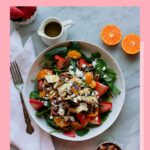Grilled chicken spinach salad with strawberries, oranges, pecans and poppyseed dressing.
