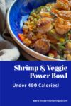 Veggies in bowl with shrimp on top in a blue bowl