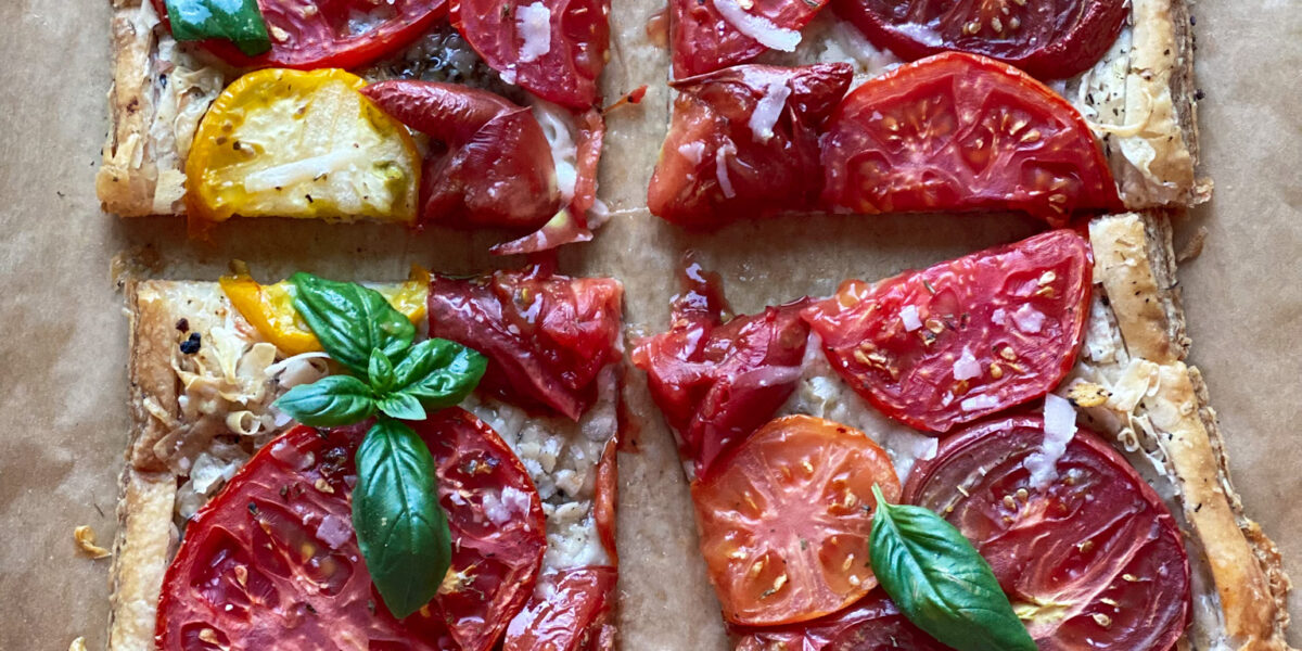 Tomato tart sliced into 4 pieces