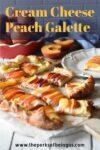 A cut up cream cheese peach galette with a bowl of peaches