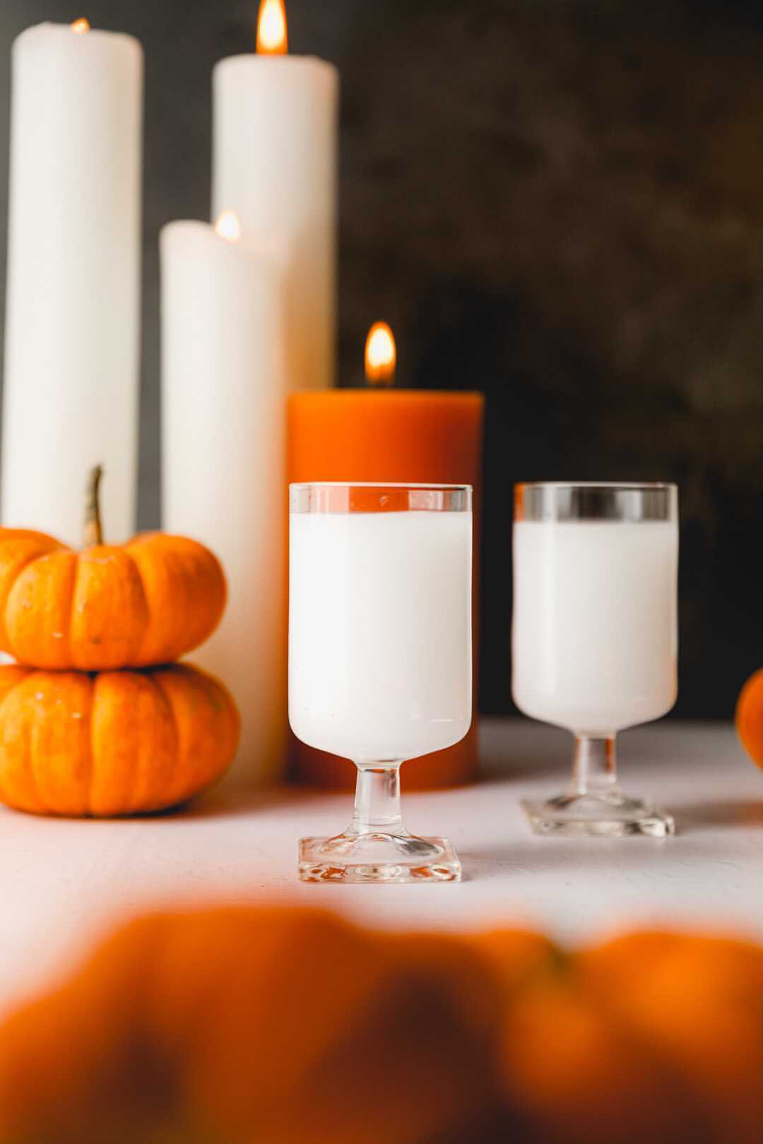 white as a ghost cocktails with candles and pumpkins
