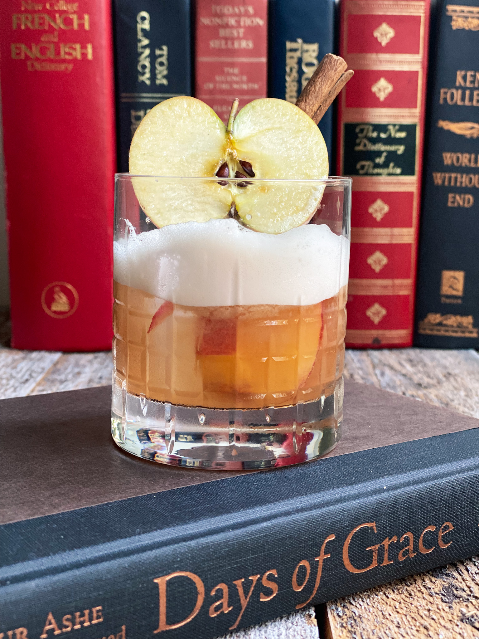 apple cinnamon bourbon sour in a book