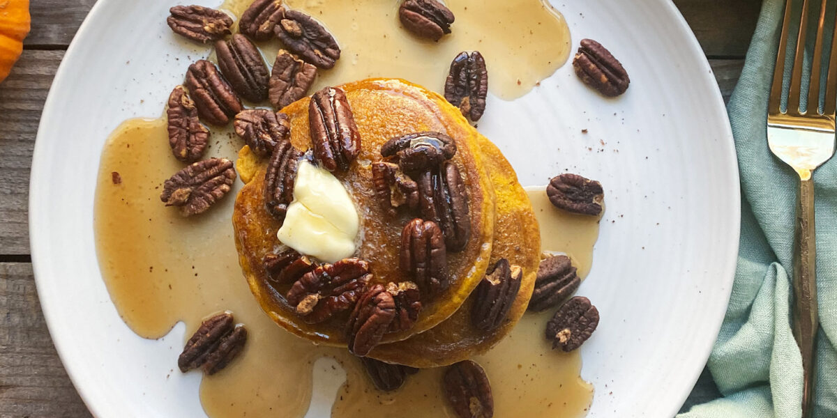 pumpkin pancakes with pecans and maple syrup
